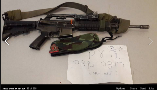 """A gun and an army beret with a sign reading: """"Bibi... the people want revenge.."""""""