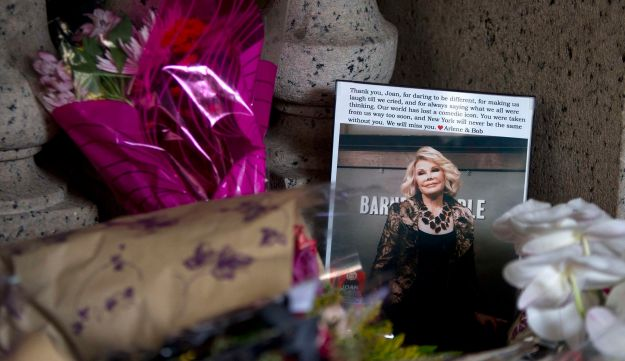Flowers and a photo, which were left in tribute as part of a makeshift memorial