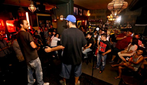 In this Monday, July 7, 2014 photo, Lebanese rappers perform during open mic show at Radio Beirut.