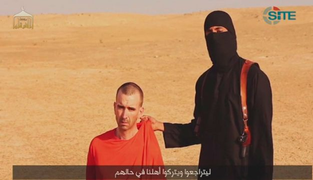 A video purportedly showing threats being made to a man Islamic State (IS) named as David Haines