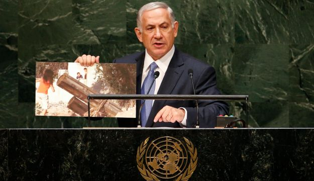 Netanyahu holds up a photograph as he addresses the 69th United Nations General Assembly.