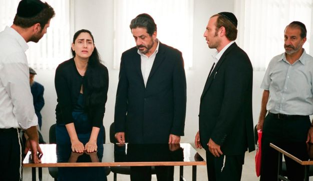 Viviane with her attorney at the rabbinical court in 'Gett.'