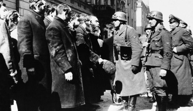 Nazi officers talking with Jews in the Warsaw ghetto in Poland in 1943.