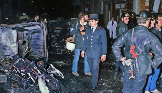 French police investigate the wreckage after a bomb attack on a Paris synagogue that killed four people, October 3, 1980.