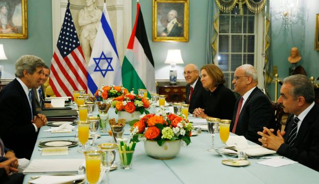 U.S. Secretary of State Kerry, left, meets with Israeli and Palestinian negotiators in 2013, shorty before diplomacy froze.