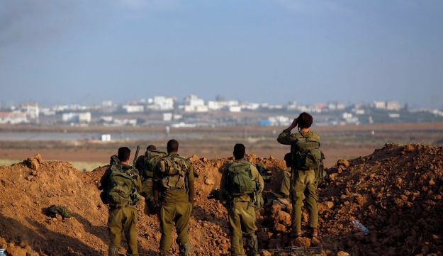 IDF soldiers looking at Gaza during this summer's war.
