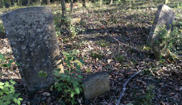 The gravestones of Jeremiah and Nathaniel Ezell.