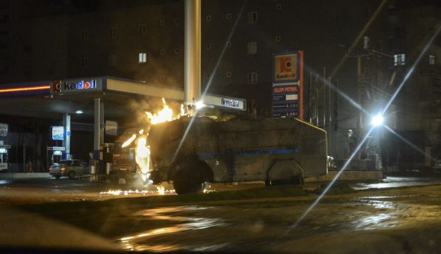 Flames rises from a water cannon during clashes between Turkish police and members of PKK