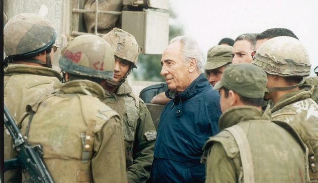 Shimon Peres, then-prime minister, talking to soldiers during Operation Grapes of Wrath in southern Lebanon, 1996.