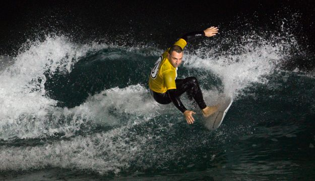 A surfer during a night surfing competition in the Mediterranean Sea in Ashdod, February 4, 2015.