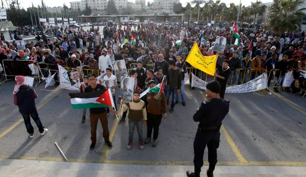 Jordanians hold a rally to show their support for the government against terror in Amman, February 5