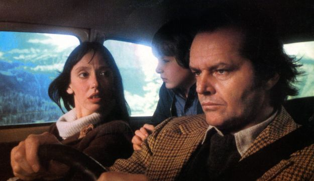 Shelley Duvall, Danny Lloyd, and Jack Nicholson in car on their way to resort in lobby card for the
