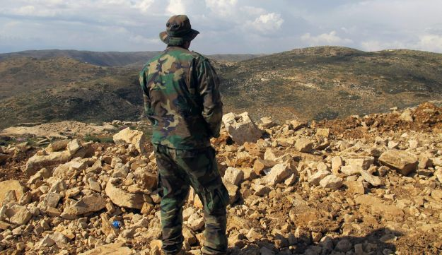 Hezbollah fighter looks toward Syria from Lebanese border village in Lebanon. May 9, 2015. (AP)
