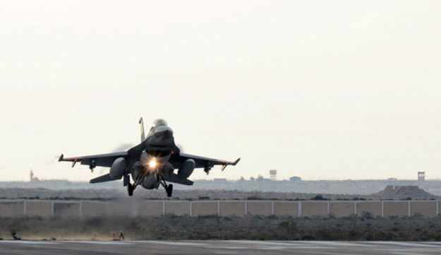 An Egyptian air force fighter jet landing at an undisclosed location in Egypt following air strikes