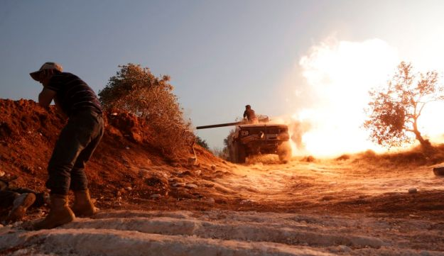 Rebels take part in offensive to take control of the al-Mastouma army base in Idlib province, Syria.