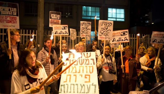 Protesters demonstrate outside Minister Shaked's home in Tel Aviv, December 26, 2015.