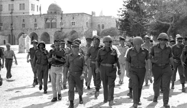 Defense Minister Moshe Dayan, IDF chief Yitzhak Rabin and others touring the Temple Mount following the Six-Day War in 1967.