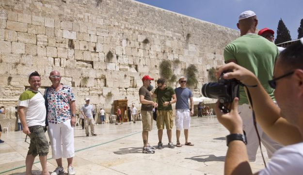 Tourists posing for a photograph in Jerusalem.