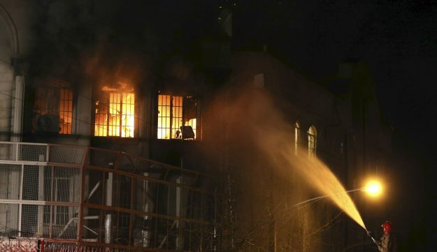 Unverified photos appear to show flames rising from Saudi Arabia's embassy during a demonstration in Tehran early on January 3, 2016.