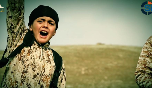 A still showing a child taking part in the reported execution of a Palestinian by ISIS.