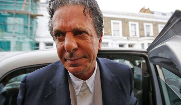 Charles Saatchi arriving home in London, June 18, 2013, after being cautioned by police for assaulting his wife Nigella Lawson, based on photographs of him grabbing her by the throat.