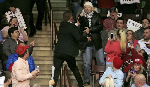 A protester against U.S. republican presidential candidate Donald Trump is removed by security personnel during a campaign event in Rock Hill, South Carolina January 8, 2016.