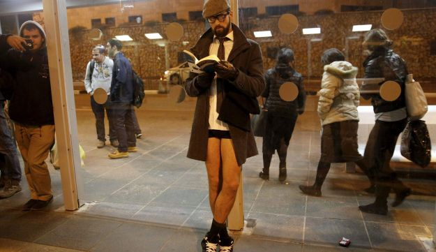 An Israeli man waits without his pants on for travel on the light rail as he takes part in the third annual 'No pants subway ride' event in Jerusalem, January 10, 2016.
