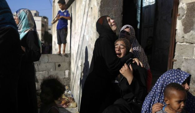 Mourners during the funeral of the four Gaza children killed in the strike. July 2014.