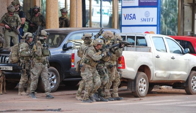 French special forces take position in the surroundings of the Splendid hotel following an attack by Al-Qaeda linked gunmen on Jan. 16, 2016 in Ouagadougou, Burkina Faso,