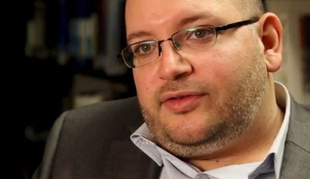 Washington Post reporter Jason Rezaian speaks in the newspaper's offices in Washington, D.C. in a November 6, 2013 file photo.
