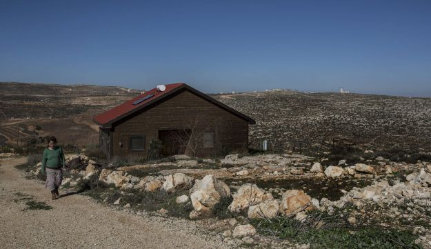 Inbal Zeev walks by her guest house in the Nofei Prat settlement, which is advertised on Airbnb, January 2016.
