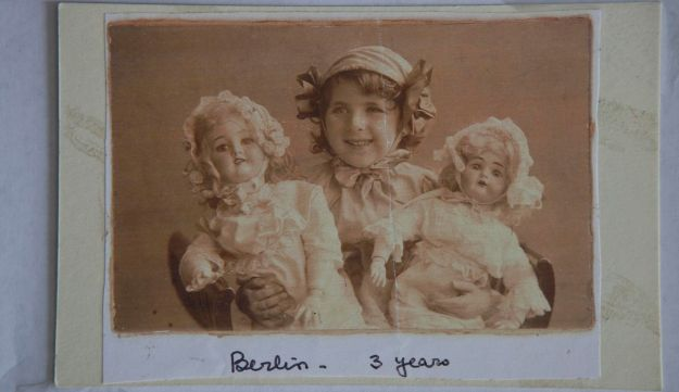 Bel Kaufman in Berlin, age 3, holding two dolls.
