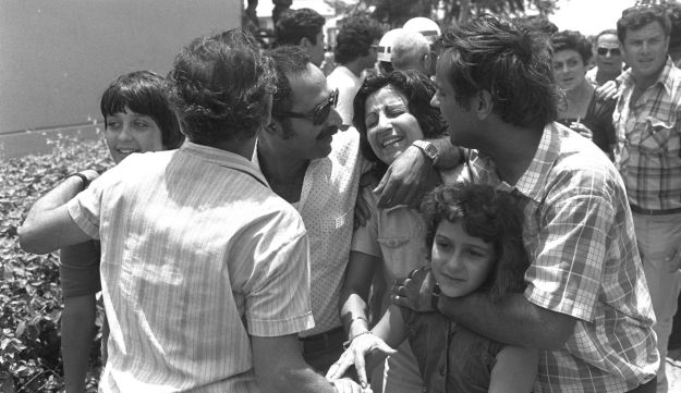 Families reunite with hostages released by the Israel Defense Forces' elite Sayeret Matkal unit during the Entebbe operation, on July 4, 1976.