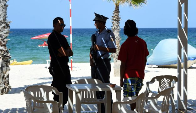 A Tunisian policeman stands