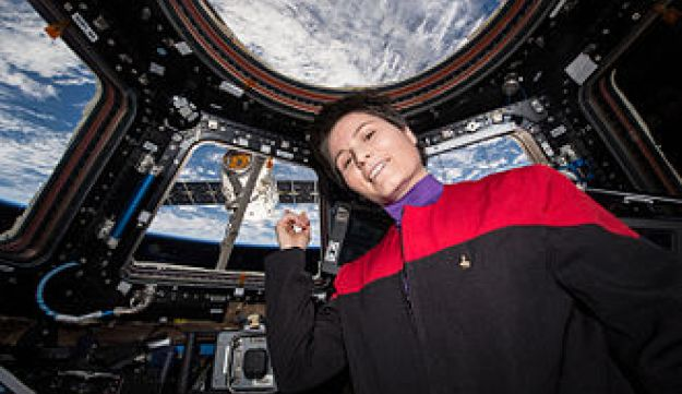Samantha Cristoforetti in the Cupola of the International Space Station, pointing at the SpaceX CRS-6 module - where she had placed the first espresso machine in space, ending the reign of instant coffee, she told the audience at Tel Aviv University.