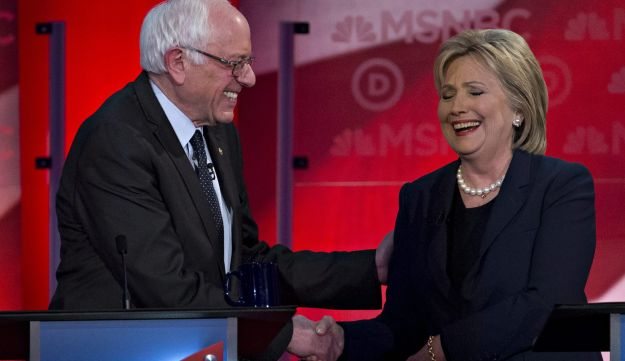 Presidential hopefuls Hillary Clinton and Bernie Sanders shake hands at the conclusion of the Democratic debate in New Hampshire on February 4, 2016.