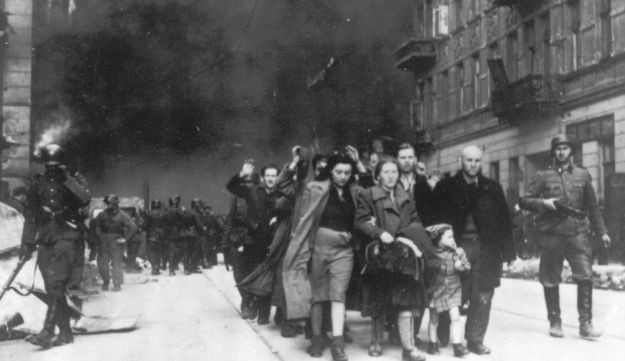 A 1943 file photo showing Polish Jews being deported by German SS soldiers.