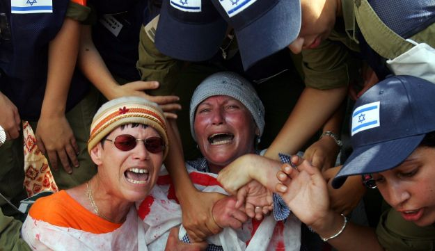 Settlers cry before Israeli police remove them from the Neve Dekalim settlement.