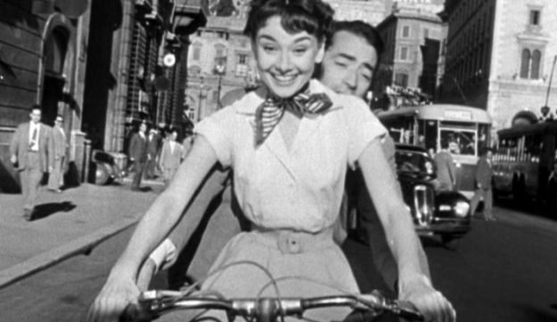 Audrey Hepburn and Gregory Peck on a Vespa.