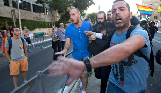 Plainclothes Israeli police detain an-ultra Orthodox Jew after he attacked people with a knife