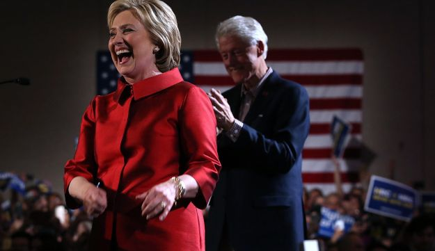 Former Secretary of State Hillary Clinton greets supporters at a caucus day event as her husband, former President Bill Clinton, looks on at Caesers Palace on February 20, 2016 in Las Vegas, Nevada.