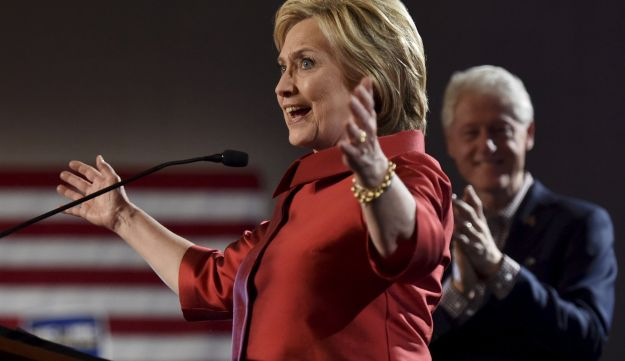 Hillary Clinton speaks to supporters as her husband Bill Clinton applauds, after she was projected to be the winner in the Democratic caucuses in Las Vegas, Nevada February 20, 2016.