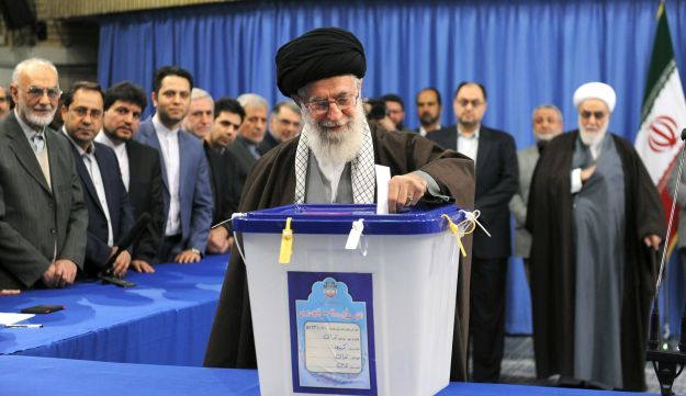 Iran's Supreme Leader Ayatollah Ali Khamenei casts his vote during elections for the parliament and Assembly of Experts. February 26, 2016.