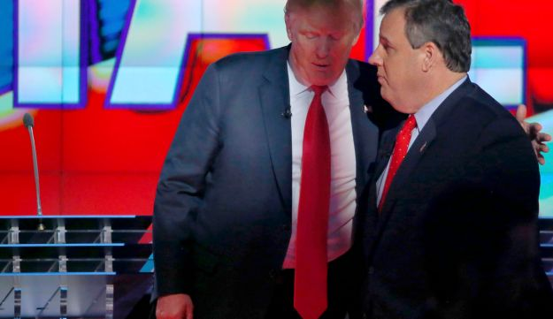 Donald Trump talks with Chris Christie at the Republican presidential debate in Las Vegas, Nevada, December 15, 2015.