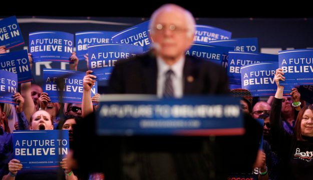 Attendees hold campaign signs as Senator Bernie Sanders speaks during a campaign event in Columbia, South Carolina. February 26, 2016.