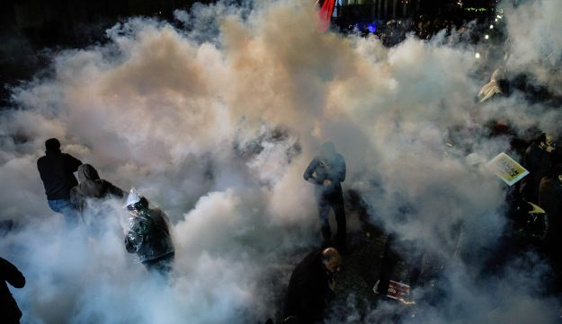 Turkish anti riot police officers launch water cannon and tear gas to disperse supporters of the Zaman Daily newspaper on March 4, 2016 in Istanbul.