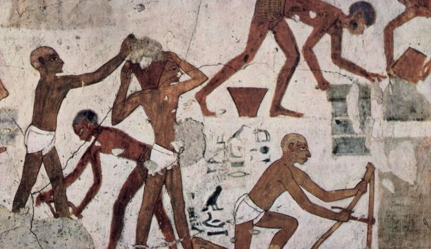 "Making bricks in ancient Egypt: The tomb of vizier Rekhimire, ca. 1450 BCE, shows foreign slaves ""making bricks for the workshop-storeplace of the Temple of Amun at Karnak in Thebes"" and for a building ramp."