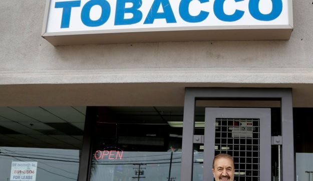 Shop owner Mohammad Yousefi stands in front of his store Trump Tobacco in Huntington Beach, California, April 6, 2016.