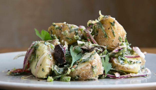 Potato salad with celery, olives and cherry aioli.