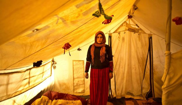 Syrian refugee Wadhah Hamada, 22, posing for a picture while being pregnant, March 16, 2015